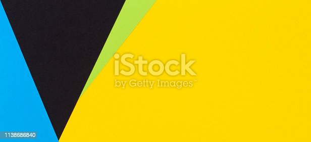 1126531335 istock photo Geometric flat lay yellow green blue and black color paper background 1138686840