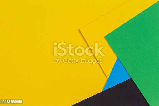 1126531335 istock photo Geometric flat lay yellow green blue and black color paper background 1138686958