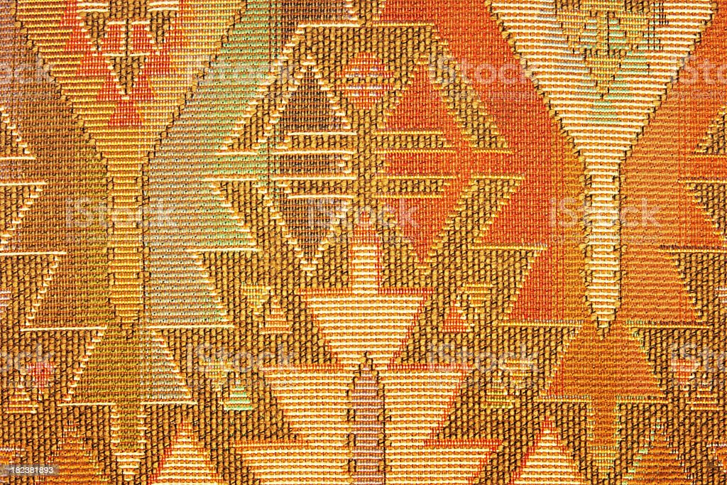 Geometric pattern on Navajo blanket or rug fabric royalty-free stock photo