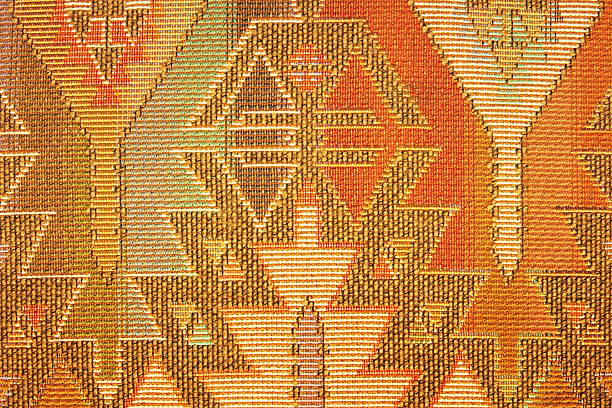 Geometric pattern on Navajo blanket or rug fabric stock photo