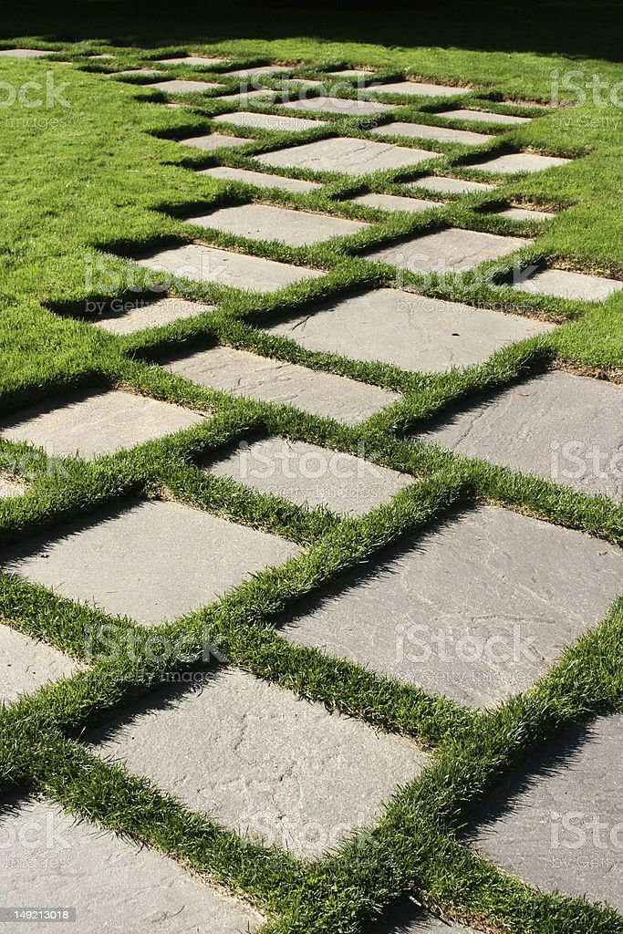 Geometric Paving Stones on Grassy Lawn royalty-free stock photo