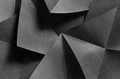 Macro image of geometric shapes of paper, three-dimensional effect, abstract background