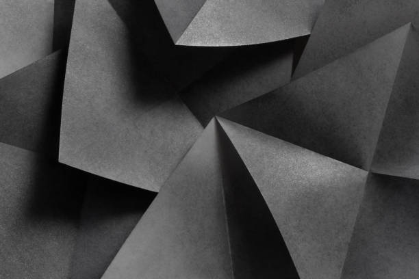 Geometric shapes in black and white, abstract background Macro image of geometric shapes of paper, three-dimensional effect, abstract background monochrome stock pictures, royalty-free photos & images