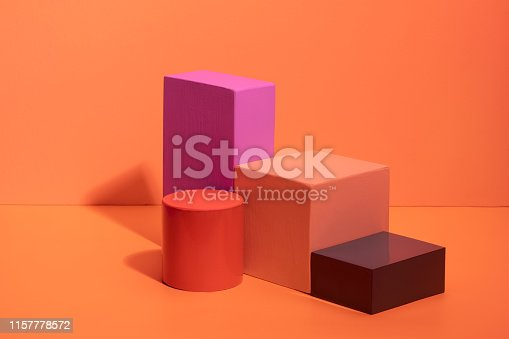 istock Geometric shapes in different colors on orange background. 1157778572