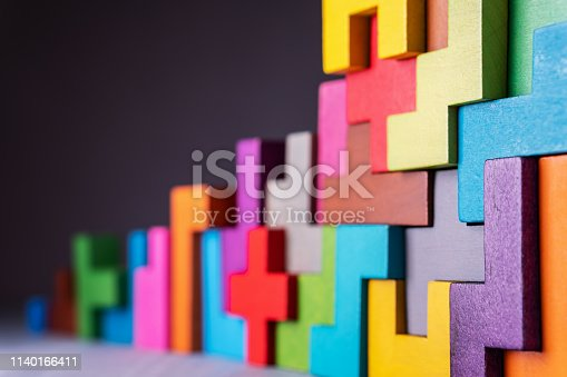 istock Geometric shapes on a wooden background. 1140166411