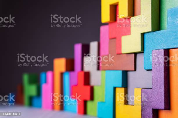 Photo of Geometric shapes on a wooden background.