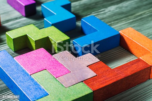 istock Geometric shapes on a wooden background. 512892492