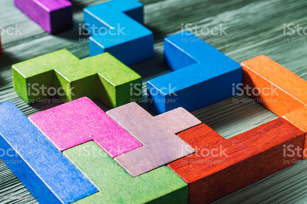 Geometric shapes on a wooden background.​​​ foto