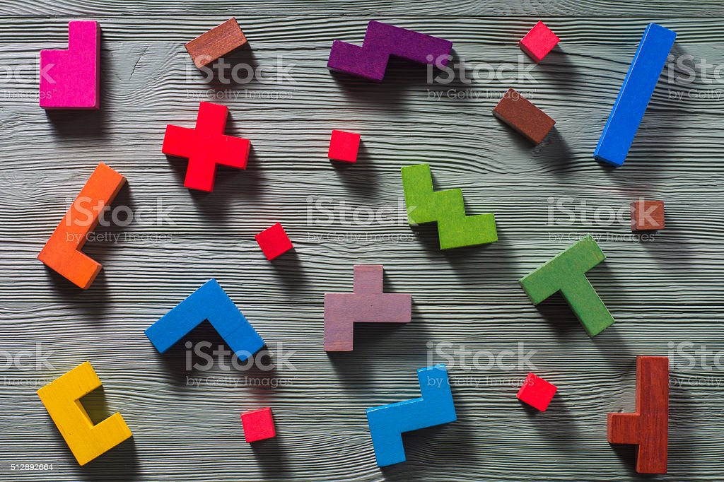 Geometric shapes on a wooden background. stock photo