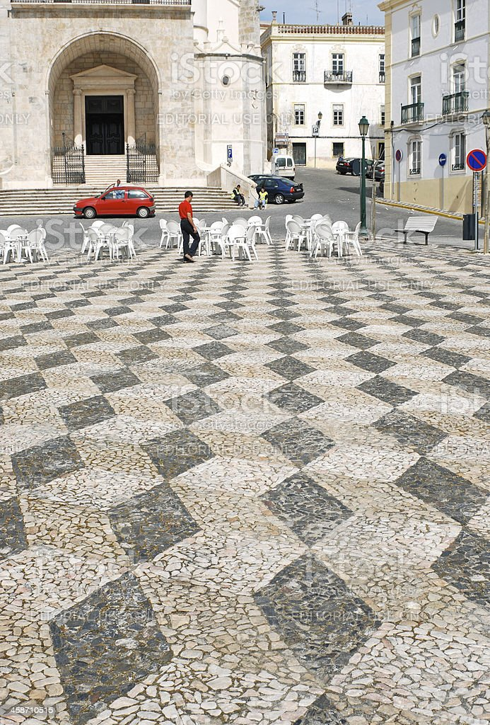 Geometric square with plastic furniture in Portugal royalty-free stock photo
