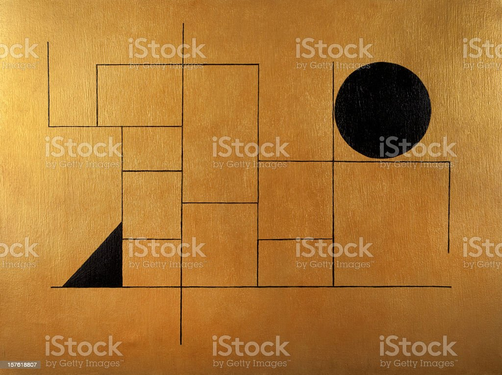 Geometric subject with black sphere and triangle on golden background stock photo