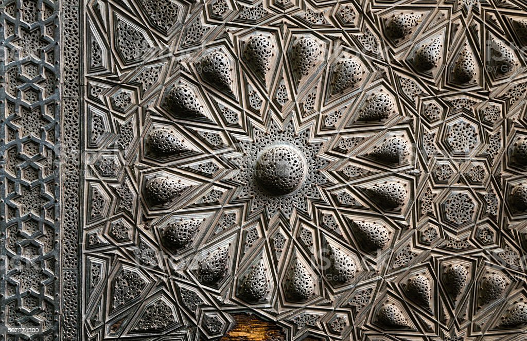 Geometrical brass decorations of an ancient historic door, Cairo stock photo