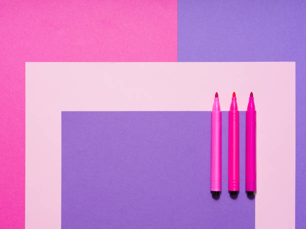 Geometrical composition with soft color papers and pens