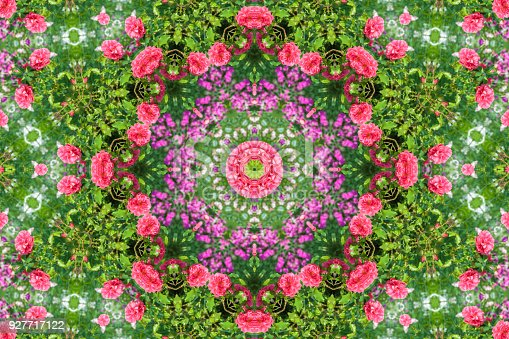 abstract background of floral pattern of a kaleidoscope. pink blue green background fractal mandala. abstract kaleidoscopic arabesque. geometrical ornament flower pattern