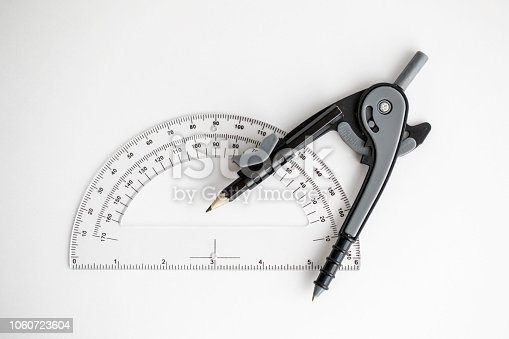 1060723604istockphoto Geometry Compass & Protractor 1060723604