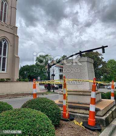 The pedestal remains, but the statue of Confederate George Davis in downtown Wilmington, NC, is removed.  Wilmington, NC, USA June 25, 2020