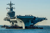 USS George H.W. Bush being moved from Northrop Grumman Shipbuilding in Newport News, Virginia to Naval Station Norfolk, Norfolk, Virginia in preparation for it's commissioning ceremony.