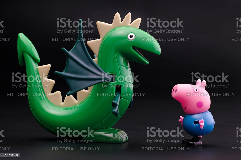 George Pig with green dinosaur on black background stock photo