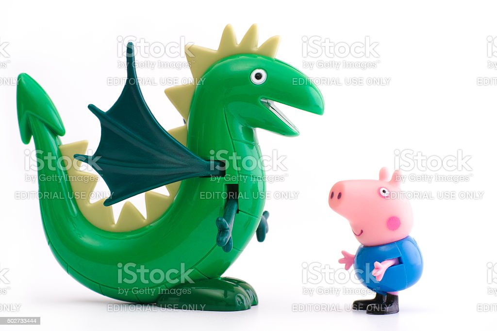 George Pig with green dinosaur stock photo