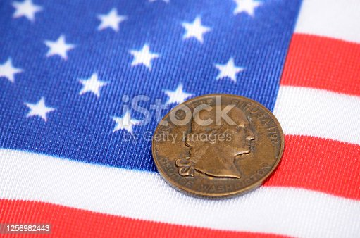 George Washington Coin on The flag of the United States of America