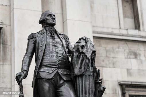 "Statue of George Washington in London. This statue of Washington is to be found in Trafalgar Square, London. It is a replica of a work by Jean-Antoine Houdon (from 1788) and, as the inscription reads, was ""Presented to the people of Great Britain and Ireland by the Commonwealth of Virginia 1924""."