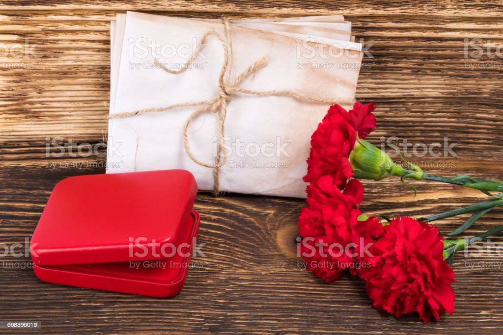 George's ribbon on the table with a red box and flowers, a beautiful victory card stock photo