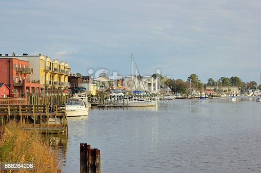 Georgetown SC harbor with colorful buildings with fishing boats, sailboats and recreational boats moored