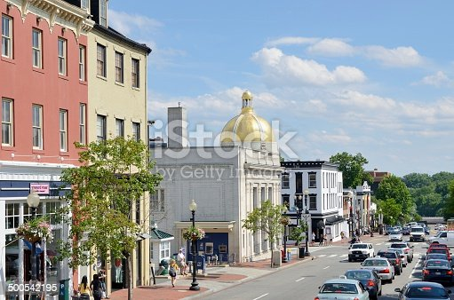 People enjoying a beautiful day in busy Georgetown. Georgetown is a historic neighborhood in Washington DC filled with quaint shops and restaurants as well as Georgetown University,