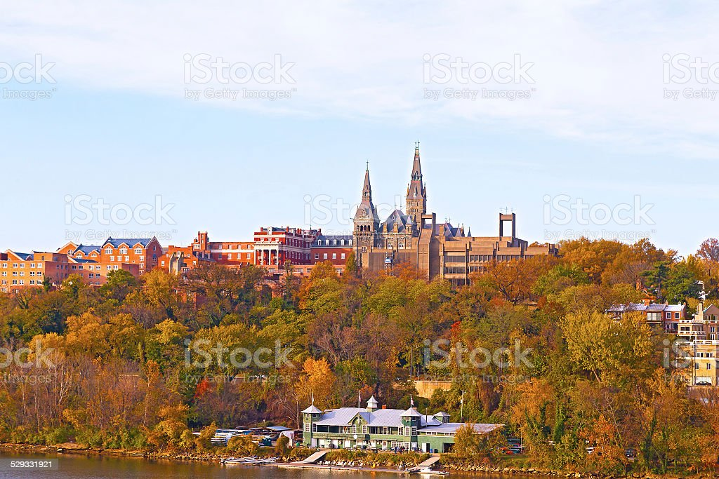 Georgetown University buildings in fall along the Potomac River. stock photo