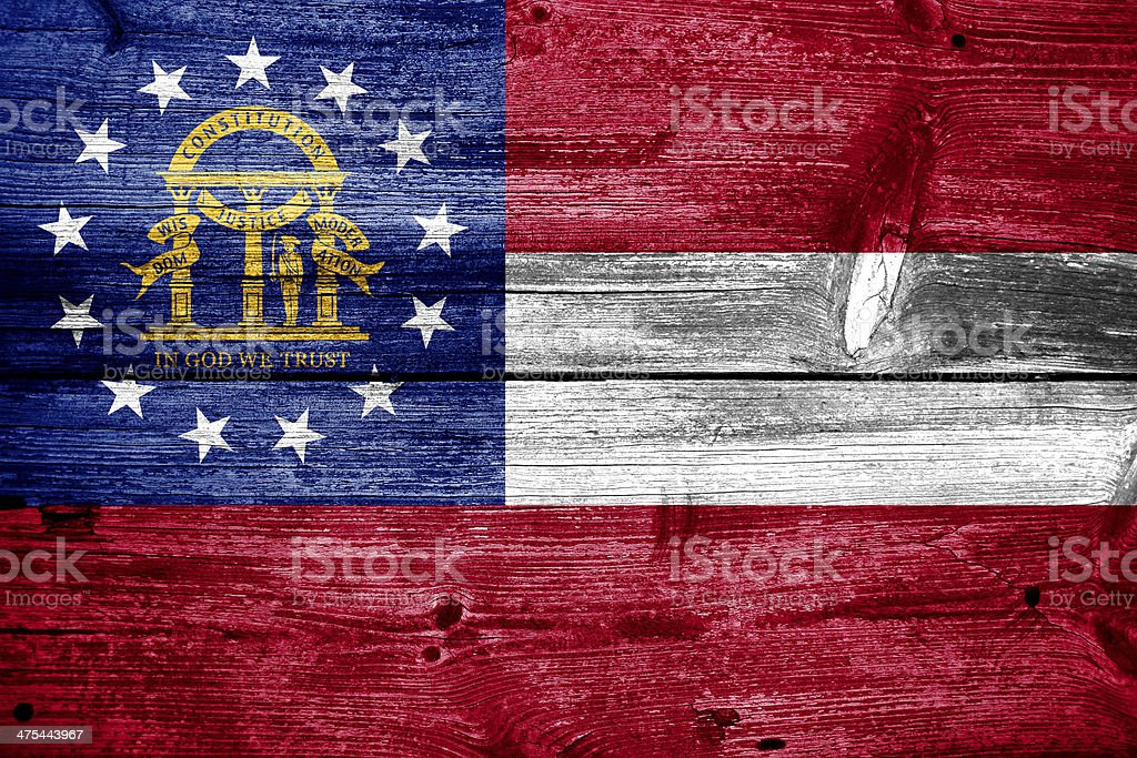 Georgia State Flag painted on old wood plank texture royalty-free stock photo