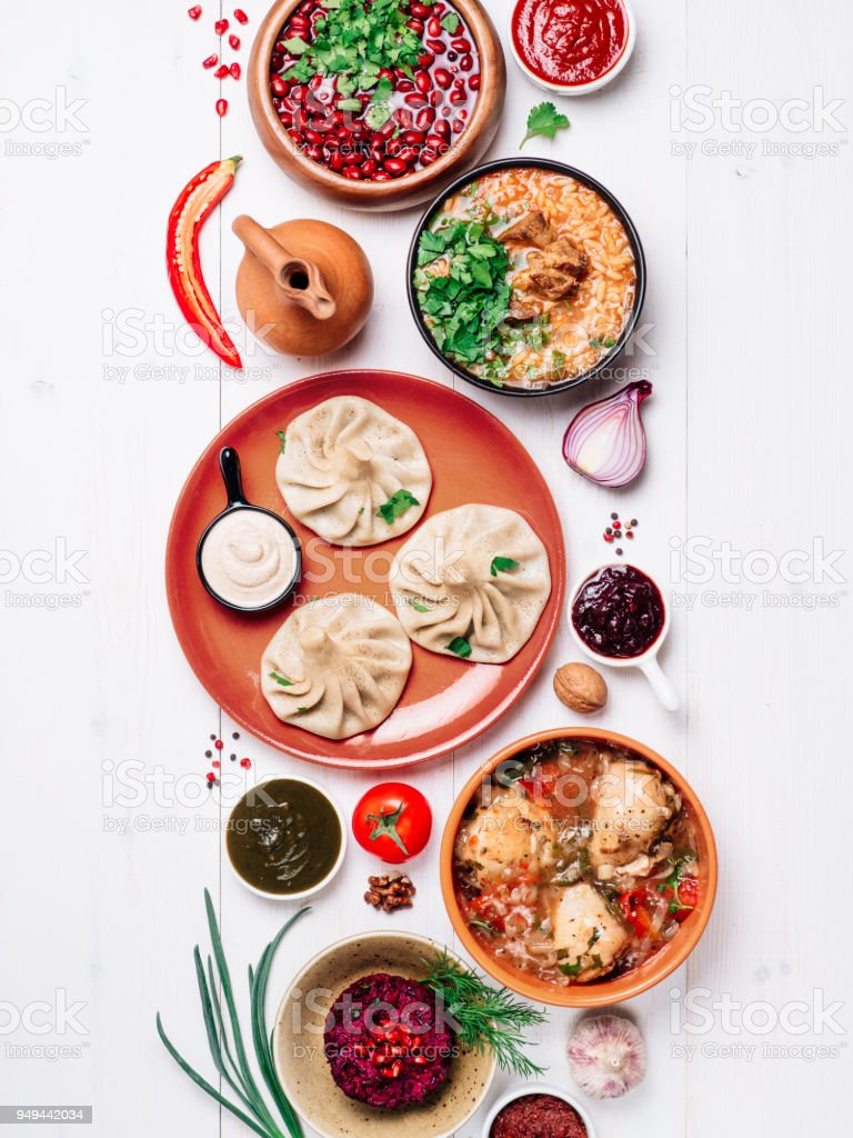 Georgian cuisine on white table top view stock photo