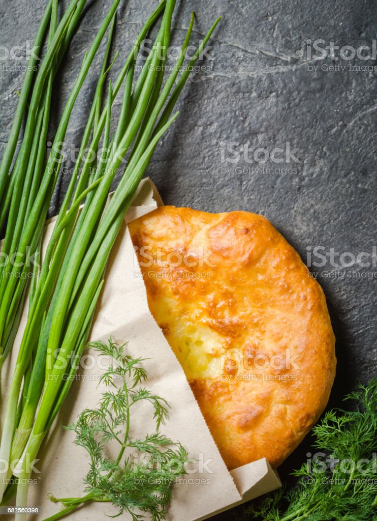 Georgian hot khachapuri bread on a dark background. Place for the text. stock photo