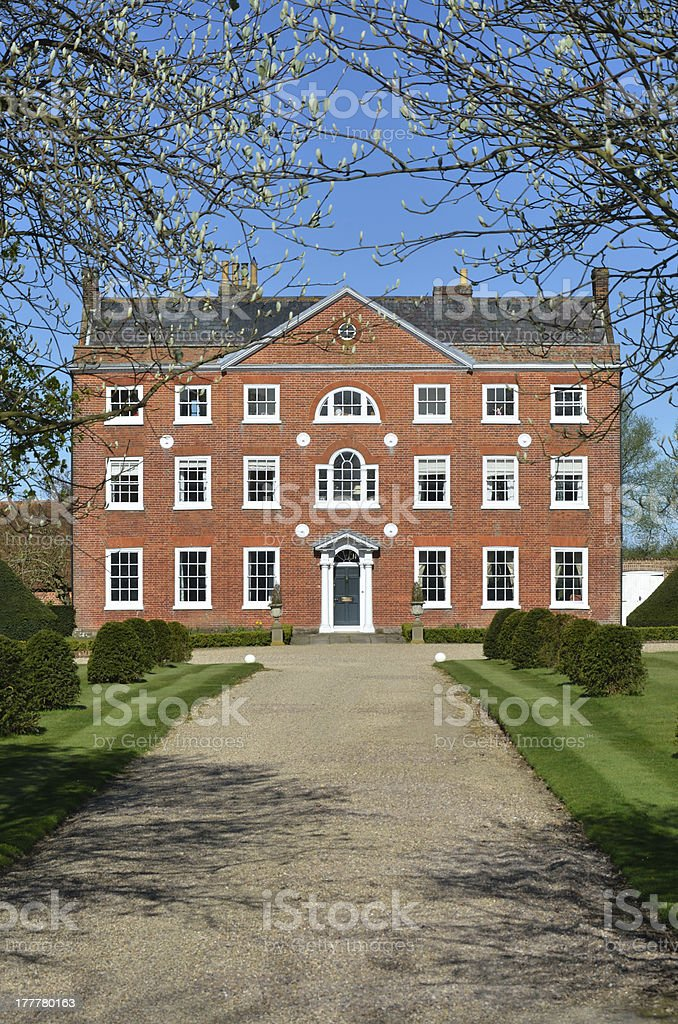 Georgian mansion with long driveway royalty-free stock photo