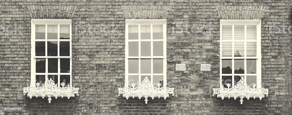 Georgian Sash Windows with Iron Railing A stock photo