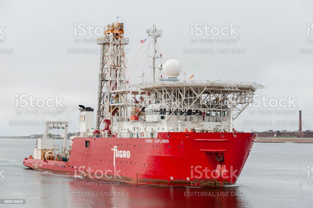 Geotechnical drilling ship Fugro Explorer nearing New Bedford hurricane barrier stock photo