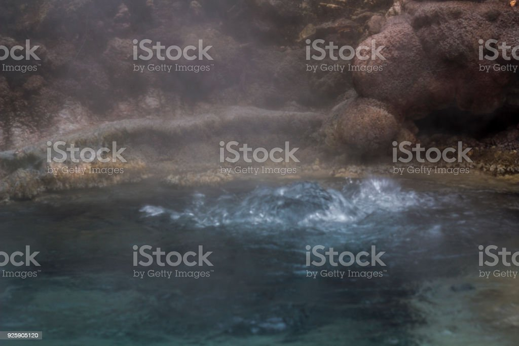 Geothermal activity, volcanic area and steam rising from terrace stock photo
