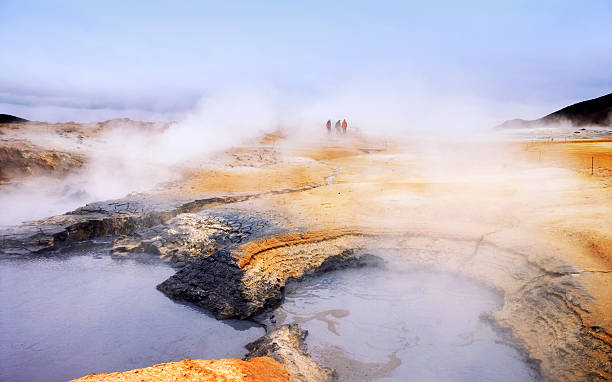 Geothermal area in Iceland Geothermal activity in Hverarönd,a geothermal field in the Lake Myvatn region of Iceland. Some tourists are walking around. namaskard geothermal area stock pictures, royalty-free photos & images