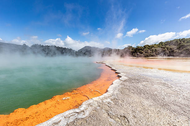 Geothermal Champagne Pool Waiotapu New Zealand Colorful Champagne Pool in the Waiotapu Thermal Wonderland. The pool is a 65 m wide spring, containing multiple minerals that are presently depositing in the surrounding sinter ledge. Waiotapu, North Island, New Zealand. rotorua stock pictures, royalty-free photos & images