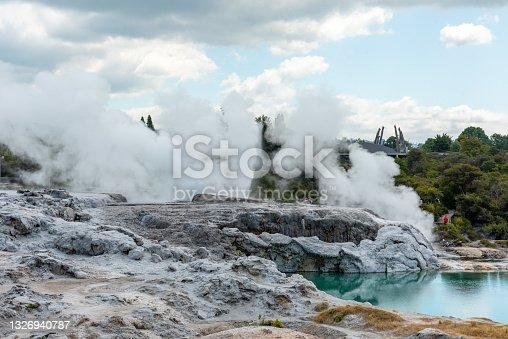istock Geothermal field with Geyser at Whakarewarewa village, New Zealand 1326940787
