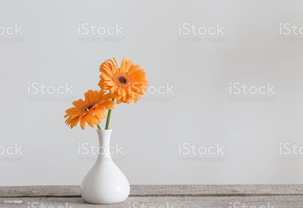 Delightful Gerbera In Vase On Old Wooden Table Stock Photo