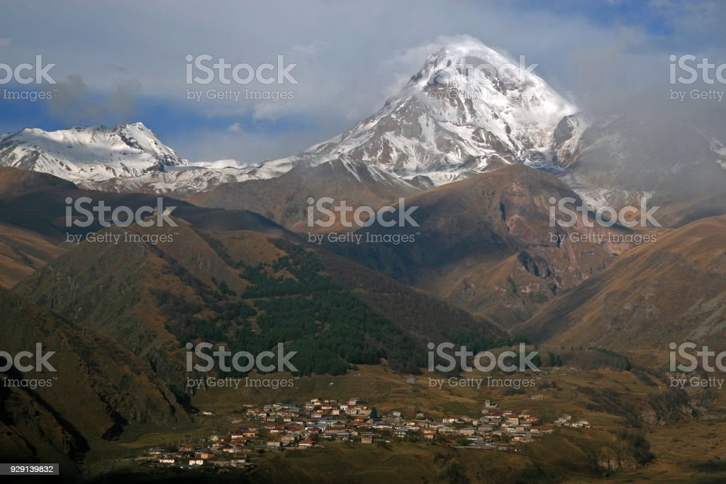 Gergeti Trinity Church and Mount Kazbegi stock photo