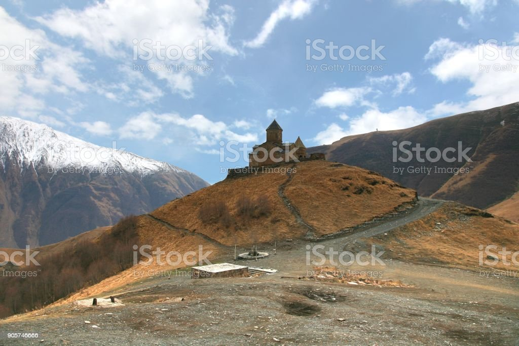 Gergeti trinity church at an elevation of 2170 meters, under Mount Kazbegi in Georgia stock photo
