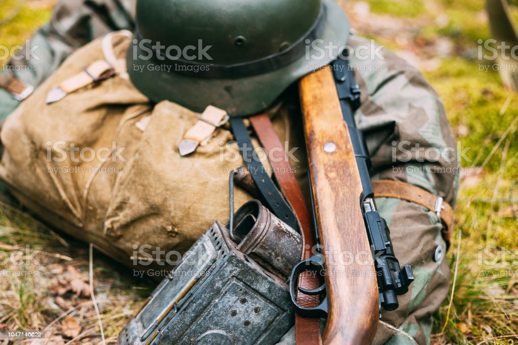 German Ammunition Of World War II On Ground. Military Helmet, Light, Rifle stock photo