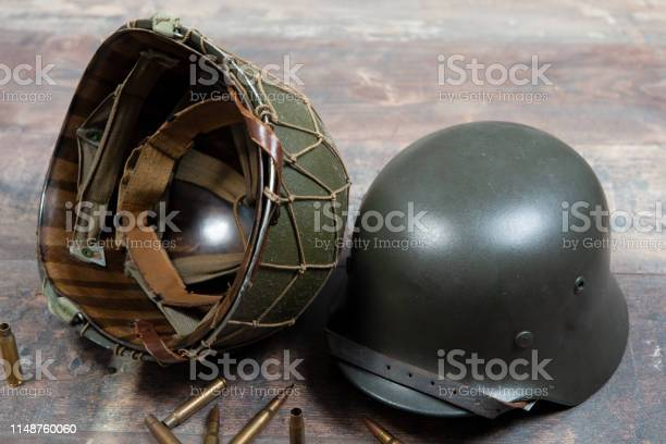 German and U.S  World War Two military helmets, battle of Normandy 1944 with ammo