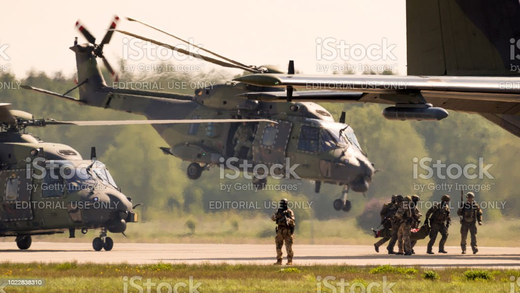 German army soldiers and helicopters in action stock photo