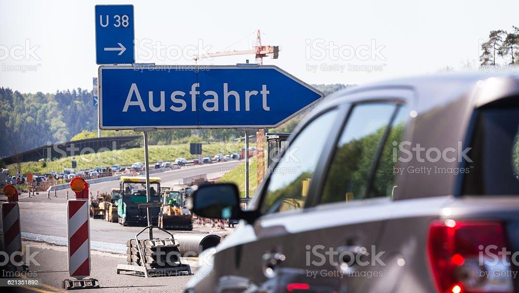 german autobahn traffic jam exit sign stock photo