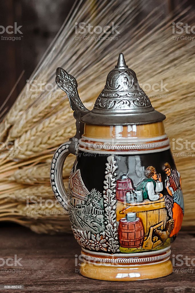 German Beer Stein and Wheat On Wood Background stock photo