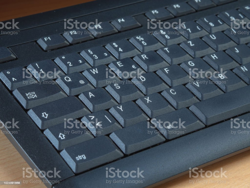 German black computer keyboard with a blank key
