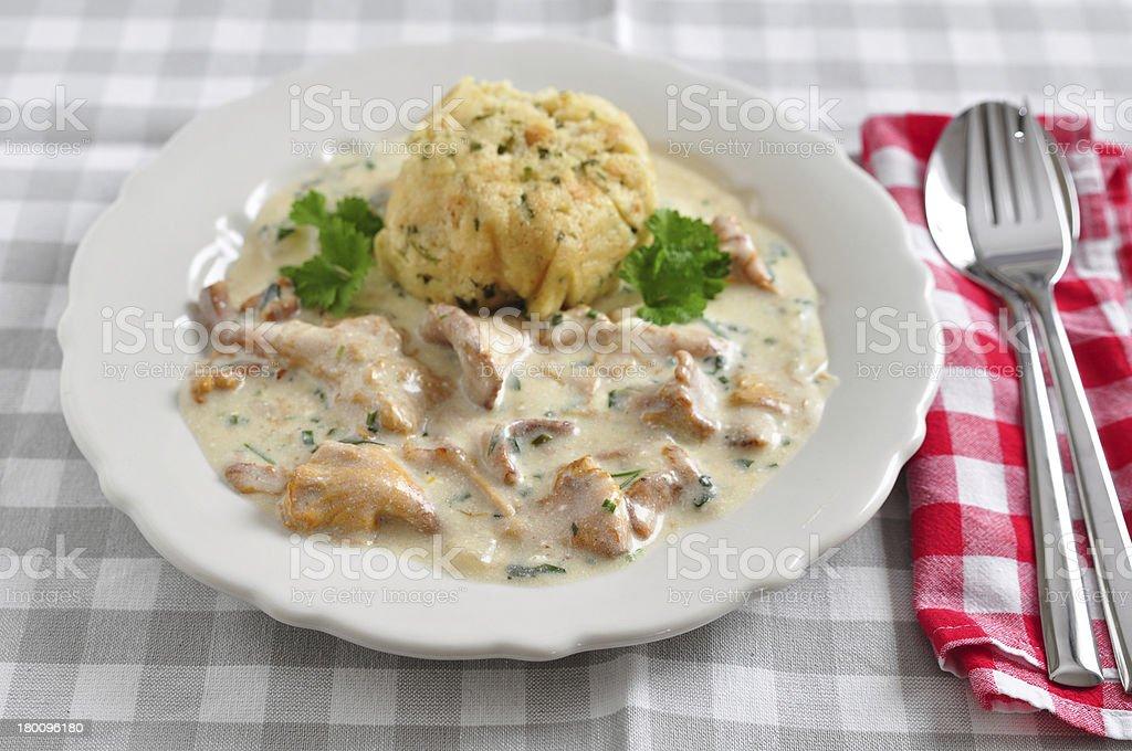German Bread Dumplings with chanterelle mushroom sauce royalty-free stock photo