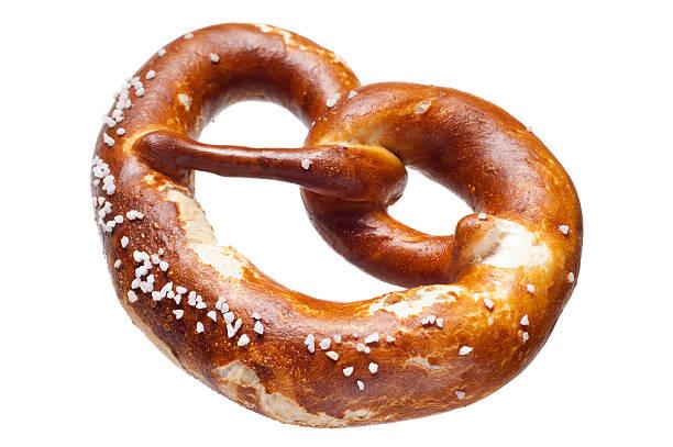 german bread pretzel on a white background - 椒鹽蝴蝶圈 個照片及圖片檔